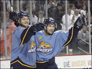 Andy Bohmbach, left, and Mike Hedden celebrate Bohmbach's first-period goal to put Toledo ahead early.