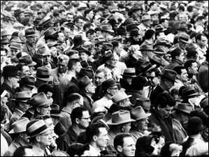 Spectators stand shoulder to should at Maumee Downs on April 6, 1959. The track was on what would become the playing field for Toledo's Triple-A baseball team, the Mud Hens, at Ned Skeldon Stadium.
