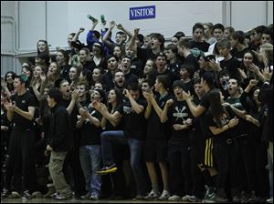 Ottawa Hills fans packed the small gym Tuesday night as the Green Bears looked to avenge an earlier loss to the Hawks.