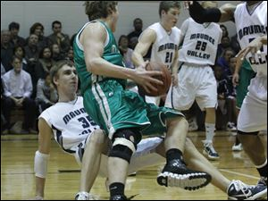 Maumee Valley's Jared Sturt (35) is floored on a charge foul by Ottawa Hills' Lucas Janowicz.
