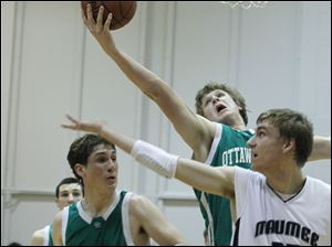 The Green Bears' Lucas Janowicz snags a rebound over the Hawks' Jared Sturt (35).