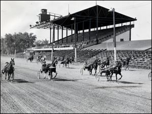 Trotters and pacers get in final workouts June 6, 1947, before the opening of a four-week harness racing program at Fort Miami. The standard breds can be seen coming down the stretch in front of the grandstand in a morning drill. The site, which later became Maumee Downs, is now the location of the Lucas County Fairgrounds.
