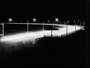Fort Miami Fairgrounds made horse racing history in 1929 as the first track to install a lighting system for nighttime running. Engineers from Toledo Edison Co. planned and installed the lighting. Many of the 600 horses quartered here were used over several weeks to test the track for shadows and glare, both for the horses and spectators.
