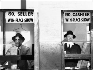 Tellers Bill Pote, left, and Neil Sullivan stand at the wagering windows May 14, 1959, at Maumee Downs. Bets to