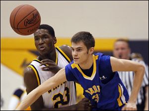 Whitmer's Nigel Hayes (23) knocks the ball away from Findlay's Brock Ammons (35).