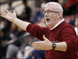 Central Catholic coach Marty McGurk shouts instructions to his team during the City League tournament semifinals.