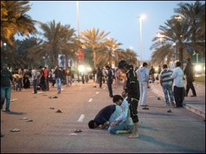 Protesters pray in the streets of Pearl Square in Manama, capital of Bahrain, and the scene of clashes with government forces. Protesters have turned defiant against the entire ruling system after the brutal crackdown there.