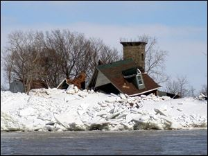 Ice floes in 2009 wrecked a house on little Turtle Island.
