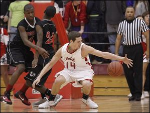 Central Catholic's Jay Marquette (14) grabs a loose ball as Rogers' Glandoy Hill (4) and Dominique Jackson (24) collide.
