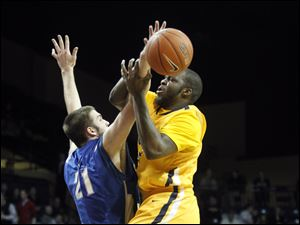 Toledo's Malcolm Griffin to the basket against Eastern Illinois' Shaun Pratl.