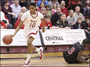 Central Catholic's Dareon Jones (1) steals the ball from Rogers' Tony Kynard (3). The Irish defeated the Rams 6-49.