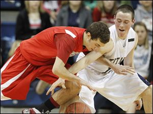 St. John's Jesuit's Nick Felhaber (10) steals the ball from Bowsher's Justin Neptune (5).