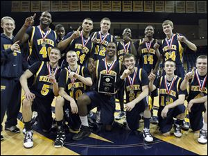 Whitmer High School players celebrate after defeating St. John's Jesuit 51-48 in the City League Championships.
