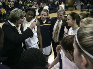 Head coach Tricia Cullop and her team is joined by University of Toledo President Lloyd Jacobs during the second half. against Eastern Michigan at Savage Arena.