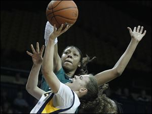 University of Toledo's Naama Shafir is guarded by Eastern Michigan's Paige Redditt. Shafir would pour in 32 points for the Rockets, the most she's ever had in Savage Arena.