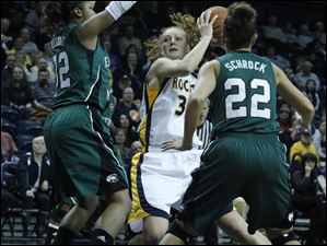 Eastern Michigan's Paige Redditt, left, and Cassie Schrock guard UT's Melissa Goodall.