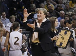 Toledo head coach Tricia Cullop applauds her team during game against Eastern Michigan at UT's Savage Arena.