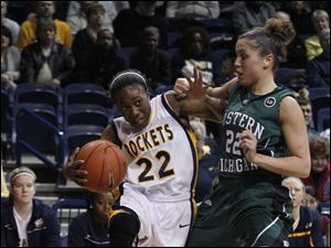 Toledo's Andola Dortch dribbles around Eastern Michigan's Cassie Schrock.