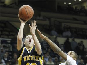 Whitmer's Ben Syroka (10) puts up a shot against St. John's Tarvis Malone, (12).