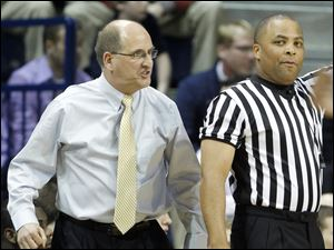 Whitmer High School head coach Bruce Smith gives the referee an earful during the second quarter.