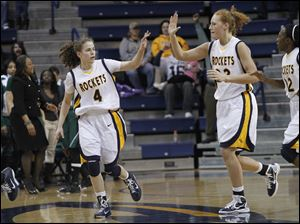 Toledo's Naama Shafir high-fives teammate Melissa Goodall.