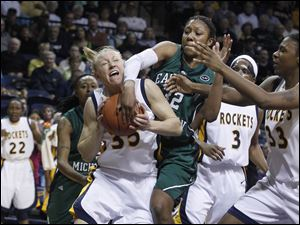 UT's Haylie Linn is fouled by Eastern Michigan's Paige Redditt.