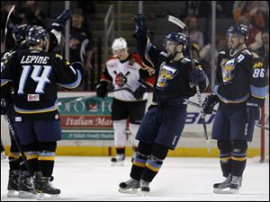 Toledo's Mike Hedden, right, celebrates scoring a goal against Wheeling at the Huntington Center.