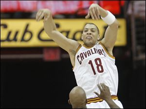 Cleveland's Anthony Parker passes over New York's Chauncey Billups.