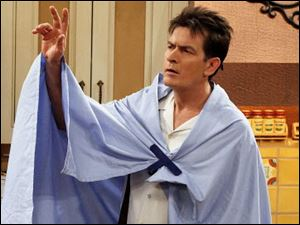Charlie Sheen, here shown in an episode of 'Two and a Half Men,' blamed producer Chuck Lorre for closing down the show.