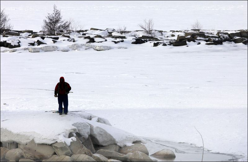 Irish hills ice fishing still hanging on toledo blade for Lake erie ice fishing