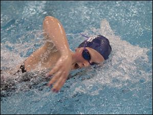 Napoleon swimmer Erika Vocke swims the final lap of the 200-yard freestyle event. Vocke placed eighth in the event.