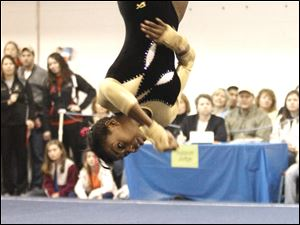 Perrysburg High School gymnast Chelsea Williams competes in the floor exercise of the District Gymnastics Tournament.