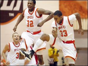 Bowling Green's Torian Oglesby (32) and Danny McElroy (33) celebrate a win over Miami on Jan. 16, 2011.