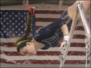 Notre Dame Academy gymnast Kelsie Steinmetz competes on the bars at the District Gymnastics Tournament.