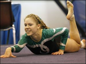 Clay High School gymnast Kylee Ault competes in the floor exercise at the District Gymnastics Tournament.