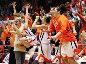 The Bowling Green State University women's basketball team reacts to beating Syracuse during the Women's National Invitation Tournament game March 22, 2009, at Anderson Arena in Bowling Green.