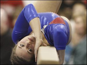 Patrick Henry gymnast Alison Storch competes on the beam at the District Gymnastics Tournament.
