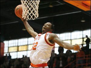 Bowling Green's Torian Oglesby dunks the ball against Miami in men's basketball action Jan. 16, 2011, at Anderson Arena.