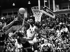 A Falcons player goes for a rebound during a Feb. 5, 1961, game against University of Toledo at Bowling Green's Anderson Arena.