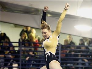 Sylvania Northview gymnast Jennelle Nearhood competes on the beam during the District Gymnastics Tournament.