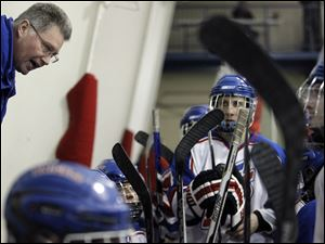 St. Francis coach Brian Kinsella speaks to his squad during the third period against Findlay.