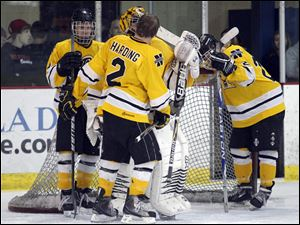 Northview players Nolan Culver, left, Austin Gryca (30), Tyler Harding (2), and Drew Korn (26) console each other after losing to St. John's a district semifinal at Tam-O-Shanter.