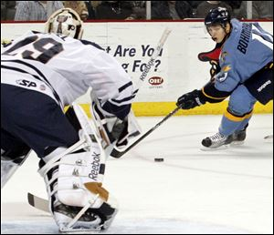 The Walleye's Andy Bohmbach moves in for a shot on Greenville goalie Nic Riopel, who earned his second shutout of the season. He stopped 24 Toledo shots.