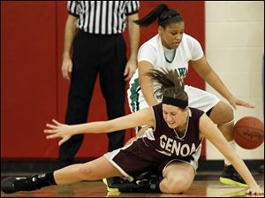 Genoa's Alyssa Meis (22) battles Ottawa Hills' Cimone Reid (23) for a loose ball.