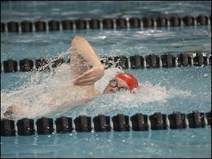 St. Francis' Matt Zimmerman swims the anchor leg of the men's 400-yard freestyle relay. The Knights took first in the event.