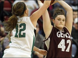 Genoa's Bailee Adams (42) passes the ball against  Ottawa Hills' Tessa Deckebach (12).