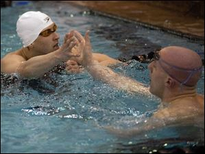 St. Francis' Michael DiSalle, left, is congratulated by his brother and teammate Dan after the men's 100-yard freestyle.