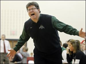 Ottawa Hills head coach Sean Mercer is upset by a call.