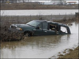 A green SUV is stuck in a water swollen ditch on southbound I-75 just south of State Rt. 613. According to The Ohio Highway Patrol, the driver hydroplaned off of the road into the ditch at about 4 a.m. Monday.  No one was seriously injured.