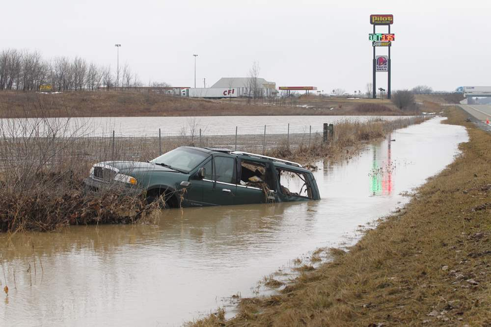 SUV-stuck-in-ditch-613